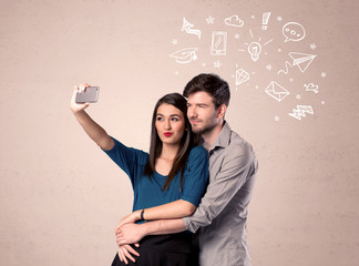Couple taking selfie with thoughts illustrated