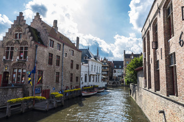Old houses along of a canal in Bruges, Belgium