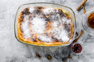 Cottage cheese casserole . Pie with cheese and cup of tea