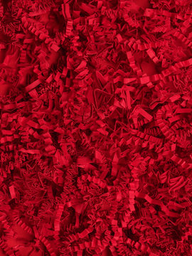 Abstract red texture of shredded paper