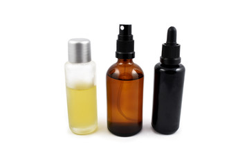 Cosmetic bottle stock images. Brown cosmetic bottle with batcher. Vials on a white background. Glass bottle of oil