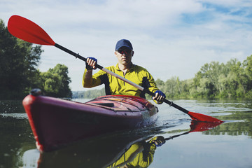 Kayak Water Sports Banner with Copy Space. Senior Kayaker on the Scenic Lake Panoramic Photo.