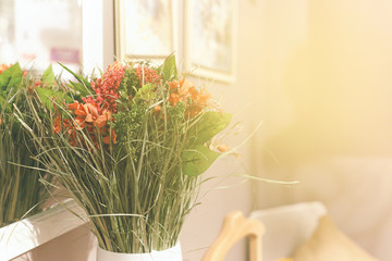 A beautiful bouquet of flowers in a white vase.
