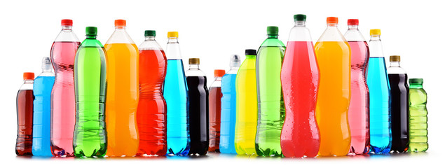 Plastic bottles of assorted carbonated soft drinks over white