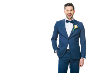 portrait of young handsome groom in suit isolated on white