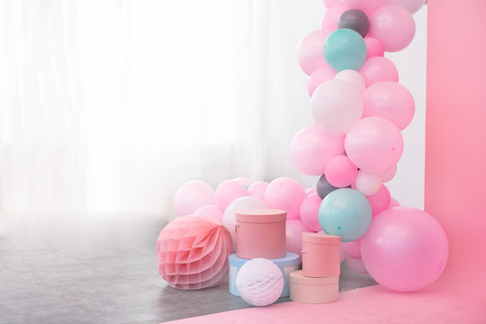 Pink balloons and boxes decoration