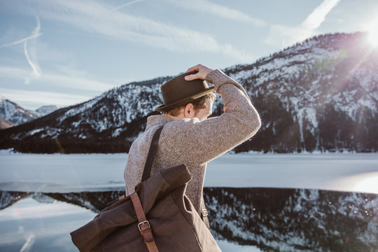 Side view of man in snowy mountains
