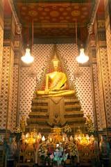 Golden sitting Main Buddha at main Prang of Wat Arun Ratchawararam temple ,Bangkok,Thailand.