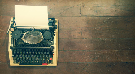 old retro   typewriter; on a wooden floor