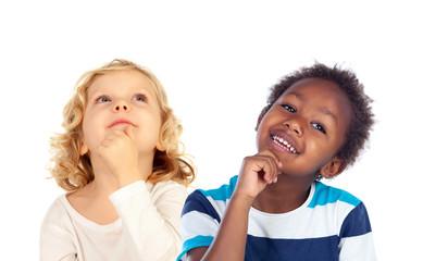 Two beautiful children thinking