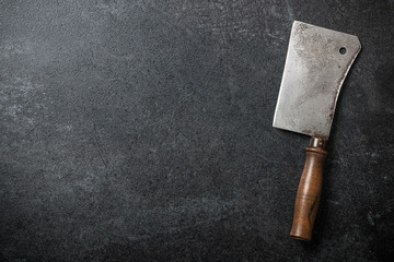 Vintage butcher cleaver on blackboard