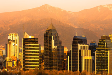 Skyline of Modern buildings in Santiago de Chile with The Andes Mountain Range in the back