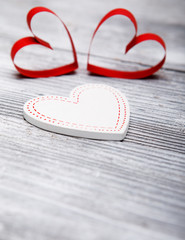 Valentine's day background with hearts on white wooden background.