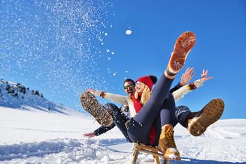 romantic winter scene, happy young couple having fun on fresh show on winter vacatio, mountain nature landscape