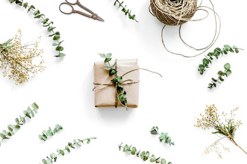 wrapping gifts concept for holiday on white background top view