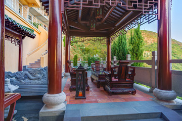 Pergola in a Chinese style with wooden table and chairs