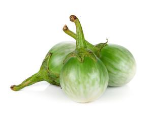 fresh organic green eggplant on white background.