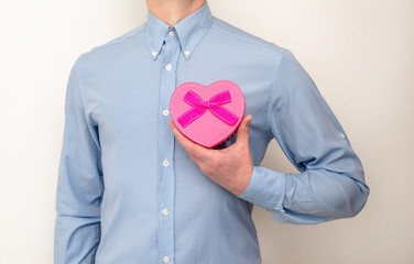 man holding a gift box in the form of heart