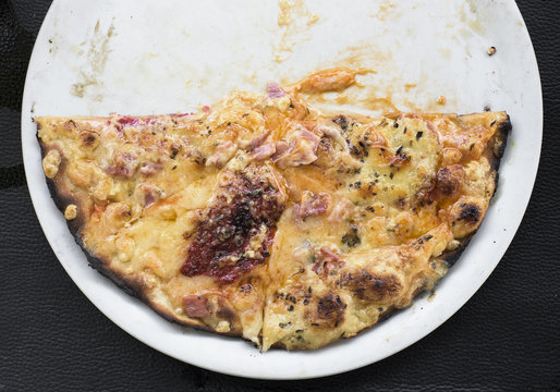 half pizza in a plate