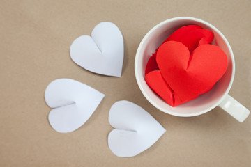 Heart-shaped paper in coffee cup Arrange as background. This is the symbol of love. For in February 14th, a day of love.