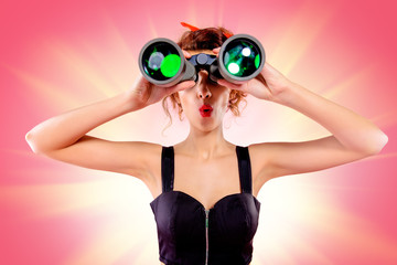 looks through binoculars