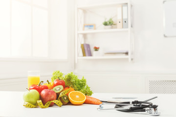 Nutritionist desk with fruit and stethoscope