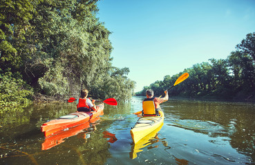 A canoe trip on the river in the summer.