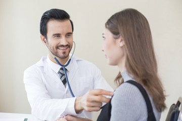 Doctor using stethoscope for listening woman. People with medical concept.