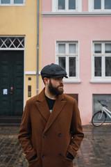 Bearded man in coat