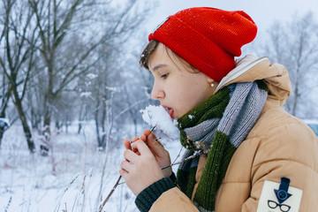 Girl winter close-ups licking snow
