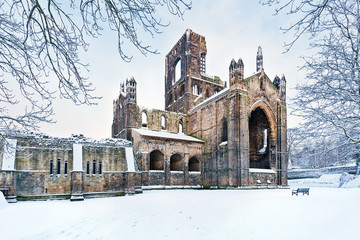 Kirkstall Abbey in snowy morning, Leeds, Yorkshire, England, UK