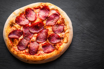 Pizza with tomatoes, cheese, pepper, herbs and olive  Ready to Eat. Fresh baked pepperoni pizza.