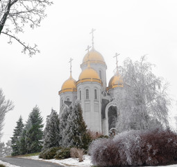Russian Church in winter mist and trees in the snow or frost on the Mamaev Kurgan in Volgograd