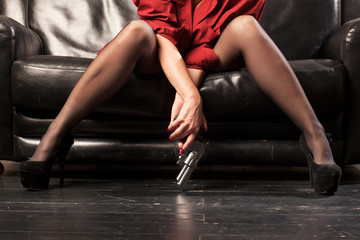 Female legs and revolver - fototapety na wymiar
