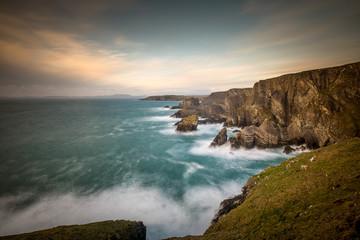 View of the ocean beating the rocks from Mizen Head, Cork, Ireland