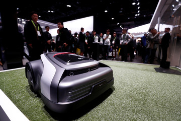An LG robotic lawn mower is displayed at the Las Vegas Convention Center during the 2018 CES in Las Vegas