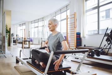 Senior Woman Doing Exercise at Gym