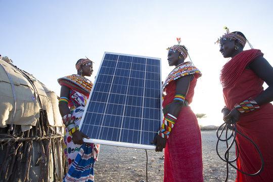 Samburu women with solar panel. Kenya.