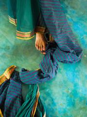 Crop shot of female foot in sari