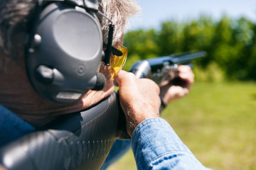 Shooting: Focus On Safety Glasses Of Man During Shotgun Shooting