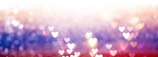 Beautiful shiny hearts and abstract lights background