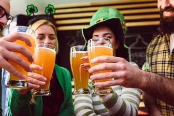 Group of Friends Celebrating St Patrick's Day in Beer Pub