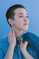 Portrait of young woman wearing denim and bolo tie