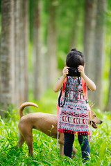 A girl take the photo in the forest.