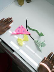 Young boy showing his Origami work