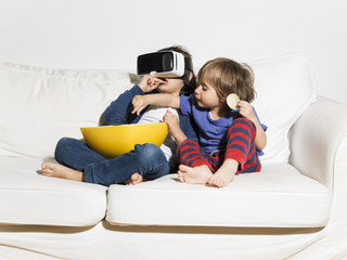 Kids having fun with VR glasses