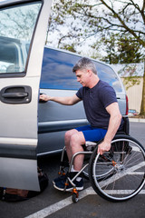 Active Disabled Athlete Closing The Door of His Car