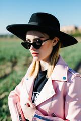 Beautiful female in hat and sunglasses