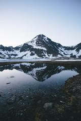 sunrise mountain reflection at rabbit lake