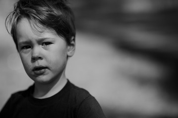 Candid Black and White portrait of child outside